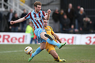 Andy Sandell of Newport County wins a tackle against David Syers of Scunthorpe. Skybet football league 2 match, Newport county v Scunthorpe Utd at Rodney Parade in Newport, South Wales on Saturday 1st March 2014.<br /> pic by Mark Hawkins, Andrew Orchard sports photography.