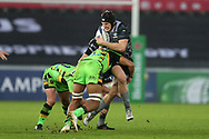 Ben John of the Ospreys is tackled by Lewis Ludlam of Northampton . European Rugby Champions Cup, pool 2 match, Ospreys v Northampton Saints at the Liberty Stadium in Swansea, South Wales on Sunday 17th December 2017.<br /> pic by  Andrew Orchard, Andrew Orchard sports photography.