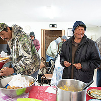 Left to right, Ernest John, Edwayne Dahozy, and Fred James line up for lunch following a service by Rev. Shiame Okunor at the Howard Chapel A.M.E. Church on Wilson, Sunday, March 3 in Gallup.