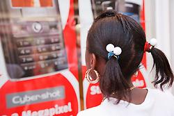 Teenage girl looking at mobile phone advert.