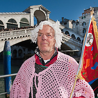 """VENICE, ITALY - JANUARY 06:  Giovanni Rossi called """"specene""""  poses for picture after winning the 34th  Befana Regata on January 6, 2012 in Venice, Italy.  In Italian folklore, Befana is an old woman who delivers gifts to children throughout Italy on the feast of the Epiphany on January 6 in a similar way to Saint Nicholas or Santa Claus."""