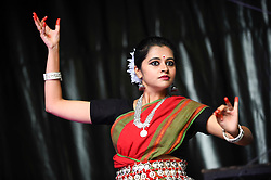 © Licensed to London News Pictures. 18/08/2018. LONDON, UK. A classical dancer performs at the ZEE London Mela, in Southall Park near to Europe's oldest Asian community in Southall, west London. Now in its 16th year, the weekend festival includes music, dance and cultural activities, inspired by South Asia and the diaspora.  Photo credit: Stephen Chung/LNP