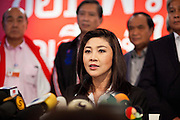 03 JULY 2011 - BANGKOK, THAILAND:  YINGLUCK SHINAWATRA, the Prime Minister elect of Thailand, announces her victory in the Thai elections during a press conference Sunday night. If her election holds she will be the first woman elected Prime Minister of Thailand. Yingluck Shinawatra and the Pheu Thai Party scored a massive landslide win in the Thai election Sunday. Pheu That is estimated to have won more than 300 seats in Thailand 500 seat parliament, so they won an absolute majority and could govern without having to form a coalition with minor parties. Pheu Thai is the latest incarnation of deposed former Prime Minister Thaksin Shinawatra's political party. Yingluck is his youngest sister. Many observers expect legal challenges to the Pheu Thai victory and the election does not completely resolve Thailand's difficult political history of the last five years.    PHOTO BY JACK KURTZ
