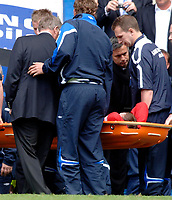 Photo: Daniel Hambury.<br />Chelsea v Manchester United. The Barclays Premiership. 29/04/2006.<br />United's Wayne Rooney leaves the pitch on a stretcher watched by Chelsea manager Jose Mourinho.