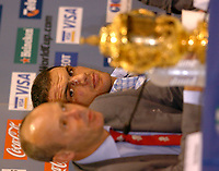 Photo: Richard Lane.<br />Australia v England. Rugby World Cup Final, at the Telstra Stadium, Sydney. RWC 2003. 22/11/2003. <br />Martin Johnson looks at the Webb Ellis Trophy at the post match press conference.