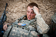 An American soldier rests after a long day of patrolling and firefights.