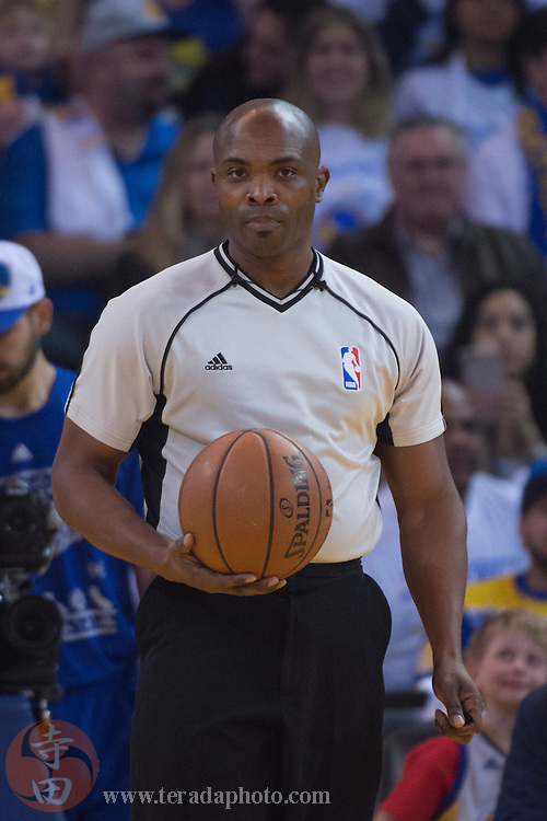 December 25, 2015; Oakland, CA, USA; NBA referee Courtney Kirkland (61) during the first quarter in a NBA basketball game on Christmas between the Golden State Warriors and the Cleveland Cavaliers at Oracle Arena. The Warriors defeated the Cavaliers 89-83.