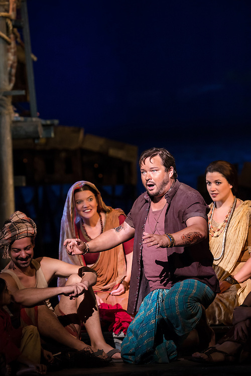 """LONDON, UK, 17 October, 2016.  Robert McPherson (foreground, in purple shirt, as """"Nadir"""") rehearses with members of the cast for the revival of director Penny Woolcock's production of Bizet's opera """"The Pearl Fishers"""" at the London Coliseum for the English National Opera.  The production opens on 19 October."""