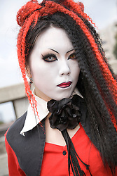 "Asia, Japan, Tokyo, Harajuku area. Female teenager in ""cosplay"" make-up and costume on Jingu Bridge."