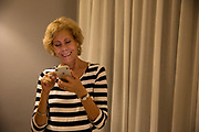 Baby Boomer on phone use and smile