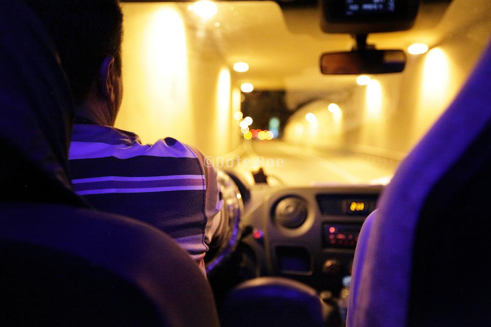 driving through a traffic underground tunnel