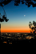 Sunset Twilight.  Looking west toward the lights of La Mesa, the coast, the Sea World Tower, and of course a new moon.