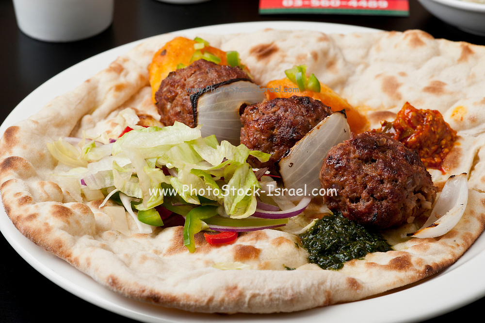 Indian Ethnical Food Keema Kofta (meat balls) on Naan Bread