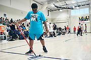 NORTH AUGUSTA, SC. July 10, 2019. Kid helps sweep the floor at Nike Peach Jam in North Augusta, SC. <br /> NOTE TO USER: Mandatory Copyright Notice: Photo by Royce Paris / Jon Lopez Creative / Nike