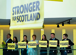 Edinburgh, Scotland, UK. 27 April, 2019. SNP ( Scottish National Party) Spring Conference takes place at the EICC ( Edinburgh International Conference Centre) in Edinburgh. Pictured; First Minister Nicola Sturgeon and other SNP politicians hold pro pro Europeplacards on balcony of the conference centre.