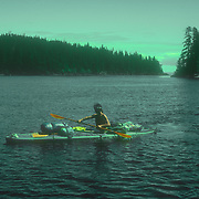 Duncan Murrell paddling his fully laden Klepper Aerius 1 folding kayak, the Brothers Islands, Stephen's Passage, Southeast Alaska, USA.<br />