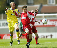 Photo: Chris Ratcliffe.<br />Leyton Orient v Peterborough United. Coca Cola League 2. 29/04/2006.<br />Matthew Lockwood (R) of Orient gets away from Peter Gain (L) of Peterborough.