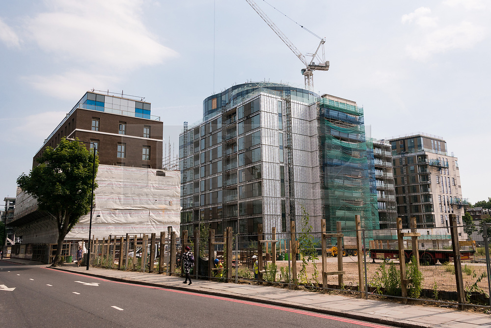"""© Licensed to London News Pictures. 21/06/2017. London, UK. Exterior view of almost finished apartment blocks in the Kensington Row complex. It was announced that sixty-eight flats will be used to house families made homeless in the Grenfell Tower fire -  for permanent occupation in July and August.  The one to four bedroom bedroom apartments sell for up to £8.5 million, will be part of the affordable quota being built and feature a more """"straightforward"""" internal specification, but have the same build quality.  The City of London Corporation is acquiring the 68 flats for around £10m as part of the response to the tragedy. Photo credit: Ray Tang/LNP"""
