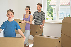 Young family father mother son moving house