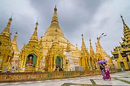 Walking in the rain at Shwedagon Pagoda in Yangon, Myanmar (Burma).