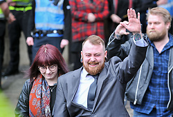 Pictured: Mark Meechan leaves court with girllfriend Suzanne Kelly after being fined.<br /> <br /> Mark Meechan (30) from Coatbridge, Lanarkshire, returns to Airdrie Sheriff Court with girlfriend Suzanne Kelly for sentencing after being convicted of filming his girlfriends pug raising it's paw in a nazi salute in response to phrases such as Sieg Heil. The clip, which was posted on Youtube, was viewed more than 3 million times. He was fined £800 GBP<br /> <br /> (c) Dave Johnston / Eem