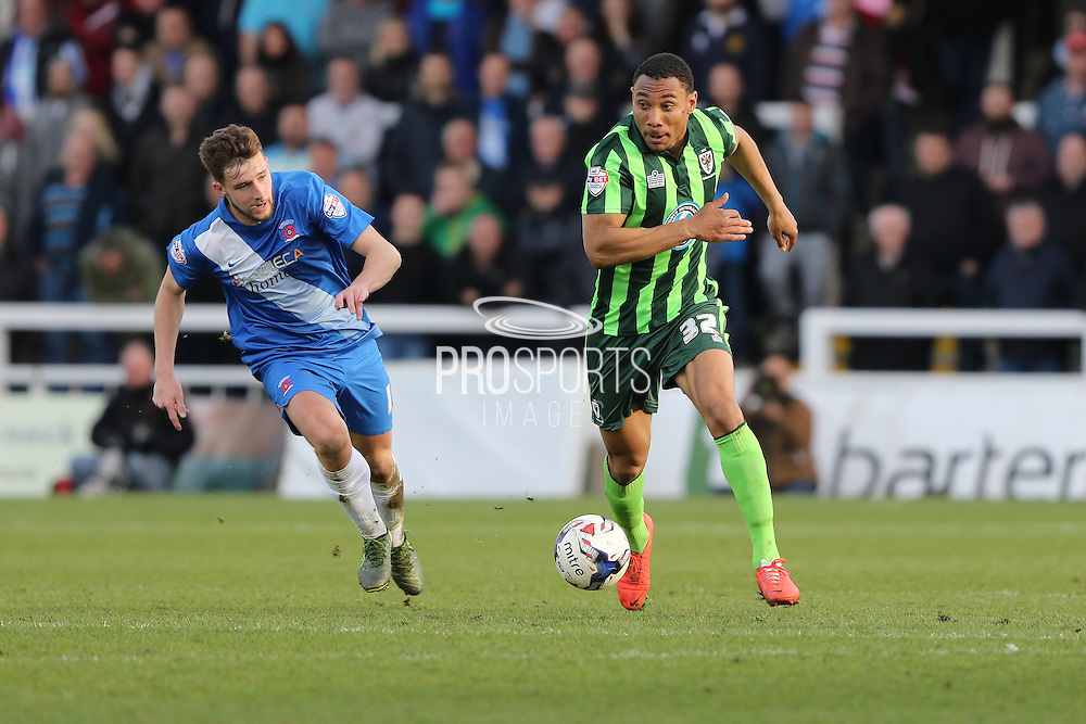 Hartlepool United midfielder Lewis Hawkins (18) chases down Darius Charles defender for AFC Wimbledon (32) during the Sky Bet League 2 match between Hartlepool United and AFC Wimbledon at Victoria Park, Hartlepool, England on 25 March 2016. Photo by Stuart Butcher.