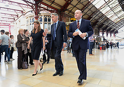 Chancellor of the Exchequer Philip Hammond with Mayor of the West of England Tim Bowles (right) and Bristol East candidate Theo Clarke (left) while campaigning at Bristol Temple Meads railway station.