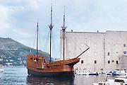 The Karaka 16 century galleon replica boat in the old harbour. The Saint John's fort in the background Dubrovnik, old city. Dalmatian Coast, Croatia, Europe.