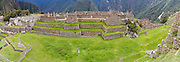 Panoramic view of the Main Plaza at the Incan ruins of Machu Picchu, near Aguas Calientes, Peru.