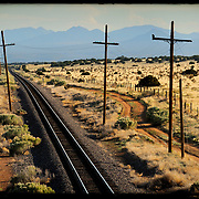 Train tracks receding into the distance looking south from the Santa Fe area, New Mexico, USA