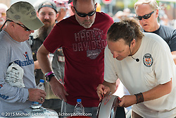 Harley-Davidson's Vehicle Collections and Restorer Specialist Bill Rodencal at a pin striping demo at the new Harley-Davidson Rally Point on Harley Way and Main Street during the75th Annual Sturgis Black Hills Motorcycle Rally.  SD, USA.  August 4, 2015.  Photography ©2015 Michael Lichter.