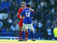 Football : Everton v Liverpool 19/04/2003. Credit : Colorsport/Matthew Impey<br /> Steven Gerrard (Liv) and Wayne Rooney (Everton) embrace at the final whistle.
