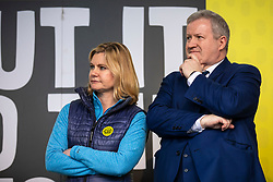"© Licensed to London News Pictures. 23/03/2019. London, UK. Former Cabinet Minister Justine Greening (L) and SNO Westminster Leader Ian Blackford (R) on stage in Parliament Square after an estimated one million people marched through central London to demand that government allow a ""People's Vote"" on the Brexit deal. Several key votes will be held in Parliament in the coming week. Photo credit: Rob Pinney/LNP"