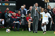 Nathan Dyer of Swansea city in action as Paul Clement, the Swansea city manager looks on. Premier league match, Swansea city v Huddersfield Town at the Liberty Stadium in Swansea, South Wales on Saturday 14th October 2017.<br /> pic by  Andrew Orchard, Andrew Orchard sports photography.
