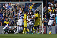 Nedum Onuoha of QPR (bottom left) pounces and scores his sides 1st goal to make it 1-0 after a mistake by Leeds keeper Robert Green.  Skybet EFL championship match, Queens Park Rangers v Leeds United at Loftus Road Stadium in London on Sunday 7th August 2016.<br /> pic by John Patrick Fletcher, Andrew Orchard sports photography.