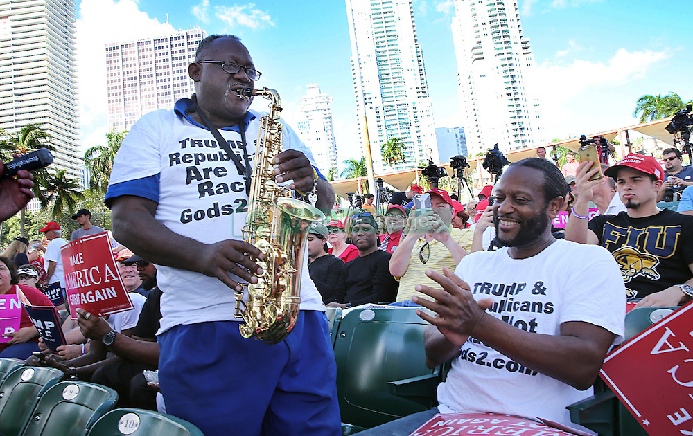 Clyde McPhatter Jr. cheers Dale Raines as he plays the saxophone for the crowd during a campaign rally for Donald Trump at Bayfront Park Amphitheater on Wednesday Nov. 2, 2016 in Miami. Photo by Pedro Portal/Miami Herald/TNS/ABACAPRESS.COM
