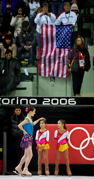 U.S. figure skater Sasha Cohen (bottom left) says hello to one of the flower girls after performing her Short Program at the Women's Figure Skating competition at the Palavela ice arena in Turin, Italy on February 21, 2006. She was on her way to wait for her scores from the judges. U.S. figure skater Sasha Cohen leads in the event with a score of 66.73. Teammate Kimmie Meissner is in fifth with 59.40 points and Emily Hughes is in seventh with 57.08..(Photo by Marc Piscotty / © 2006)