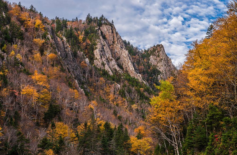 Sharp rocky cliffs and yellow fall foliage,  Dixville Notch State Park, Dixville Notch, NH