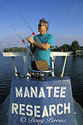 biologist Bob Bonde uses a radio antenna to locate a <br /> Florida manatee, Trichechus manatus latirostris, <br /> with a radio tag, King's Bay,  Crystal River National Wildlife Refuge, Crystal River, Florida, USA, North America