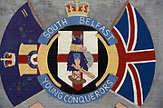 A Loyalist mural for the South Belfast Young Conquerors  including an image of an ancient warrior armed with shield and sword plus the emblem of the UVF Ulster Volunteer Force, on 7th June 1995, in Belfast, Northern Ireland, UK.