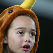 A young New Zealand fan sings the National Anthem during the New Zealand V France, Pool A match during the IRB Rugby World Cup tournament. Eden Park, Auckland, New Zealand, 24th September 2011. Photo Tim Clayton...