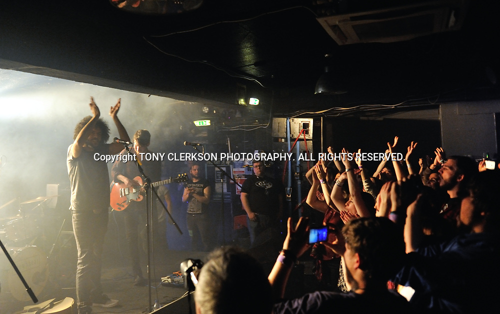 Singer-songwriter Matthew Hickman and fans applaud each other after King Tut's gig