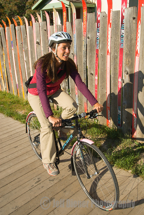 A young woman commutes on her bike in the town of Jackson, Wyoming.