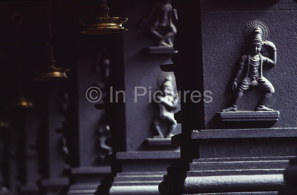 Decortative columns in the Koothambalam (a traditional theatre hall) at the Kerala Kalamandalam<br /> The Kalamandalam was founded in 1930 to preserve the cultural traditions of Kathakali, the stylised dance drama of Kerala. Kathakali is the classical dance-drama of Kerala, South India, which dates from the 17th century and is rooted in Hindu mythology. Kathakali is a unique combination of literature, music, painting, acting and dance performed by actors wearing extensive make up and elaborate costume who perform plays which retell in dance form stories from the Hindu epics.