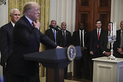 Senior advisor to the President, Jared Kushner, center, looks on as President Donald Trump speaks during a Hanukkah reception in the East Room of the White House on December 6, 2018 in Washington, DC. Behind Trump, Vice President Mike Pence. (Photo by Oliver Contreras/SIPA USA)