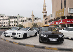 Expensive luxury cars parked inn Kuwait City, Kuwait