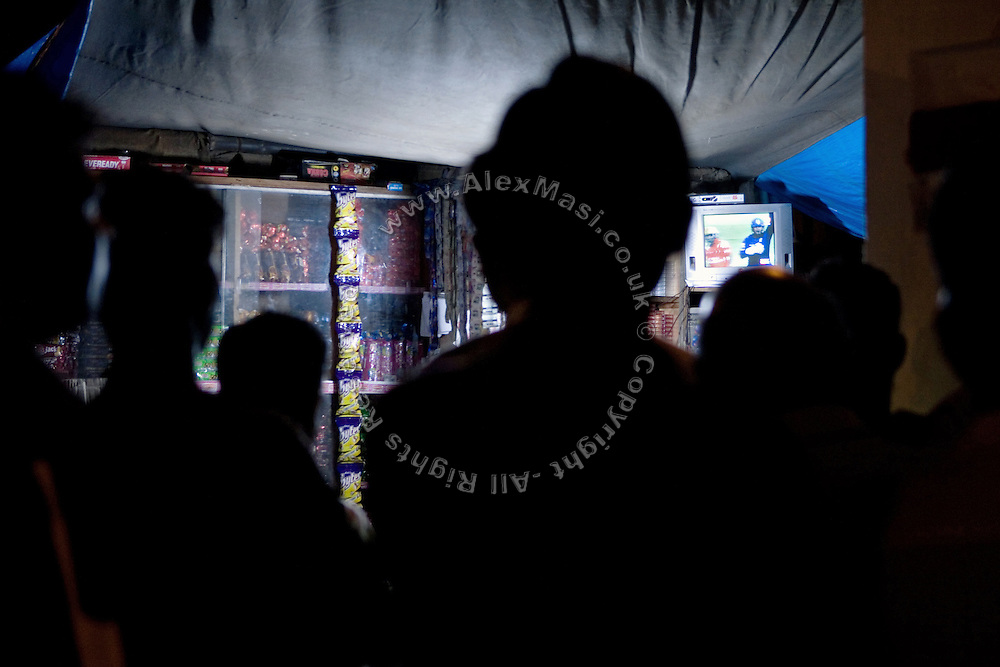 Indians are watching the national cricket finals 2009 near Churchgate Station, central Mumbai, India, on May 24th 2009. The match, played in the South African city of Johannesburg, was won by the Deccan Chargers against the Royal Challengers Bangalore. The 2009 cricket finals where played in South Africa because of national elections that were scheduled for the same period.