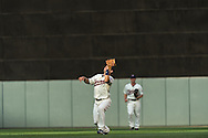 Brian Dozier #2 of the Minnesota Twins makes a pop-up catch against the Chicago White Sox on June 19, 2013 at Target Field in Minneapolis, Minnesota.  The Twins defeated the White Sox 7 to 4.  Photo: Ben Krause
