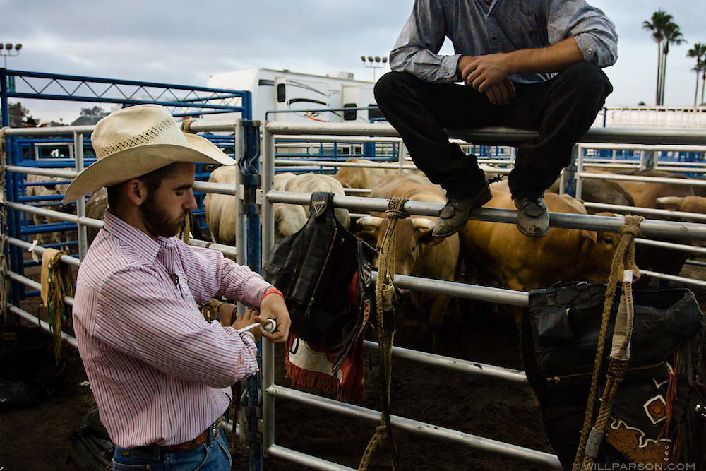 Derek Lacasa, a 20-year-old bullrider from Tres Pinos, CA tapes up his wrist before the PBR rodeo at the Del Mar Fairgrounds in Del Mar, California on July 26th, 2008.