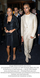 Singer MS.DYNAMITE and friend at a reception in London on 14th October 2003.PNL 528